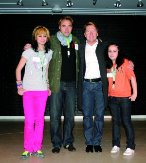 Erik Olsson, CEO at Swedish Post together with Johan Ernst and two students
